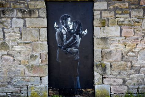 Struggling youth club removes latest Banksy from wall in