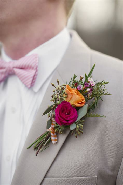 Orange and Fuschia Grooms Boutonniere | OneWed